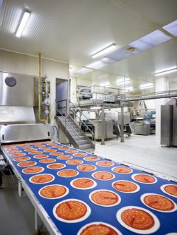 Between the high-gloss machines, the pizzas stand out as dabs of colour.