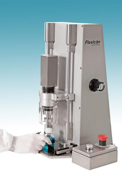 Flexicon FCE50L semi-automatic tabletop capping unit