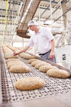 An employee checks the quality of the goods at Lieken's Bakery in Lüdersdorf.