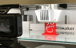 3D printer with red 3D print