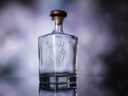 To sell high-quality spirits, the value of the brand is often communicated by the shape, colour and finishing, such as embossing and engraving. Photograph: O-I