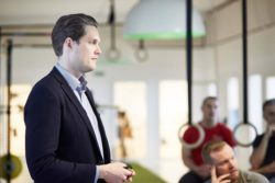 Julius Heslet, CEO of PurePharma, introduces a new product to his employees.
