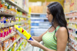 According to the FAO, 1.3 billion tonnes of food is lost each year – a share of 30 to 40 per cent. Photo: Woman checking food labelling © Korta / fotolia.com