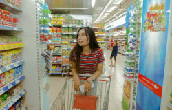 Asian woman with a shopping trolley